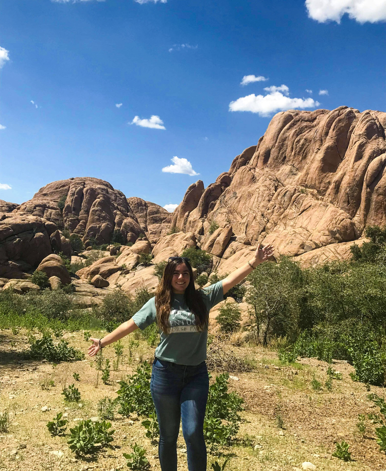 Giselle Lugo in front of large rock formation