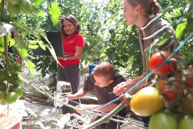 Dr. Chief in garden with students